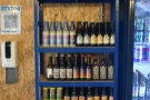 Some of the (non-chilled) beer selection on shelves next to the door.