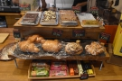 A selection of cakes and pastries sits on the counter to the right...