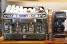 Meanwhile, the espresso machine and a Mythos One grinder are at the back of the counter.