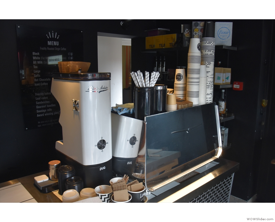 ... the Mythos One grinder reflected in the angles of the Eagle One espresso machine.