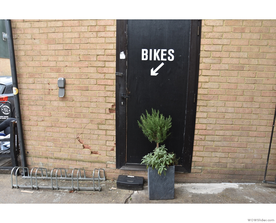 Lockdown Bakehouse has bike parking between the cafe and the seating...