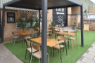 There's more outdoor seating to the right, with this strip of astro turf and its tables.