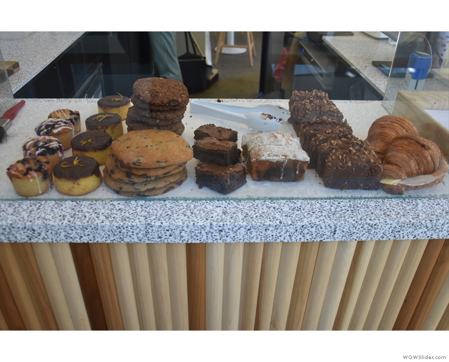 The cakes, meanwhile, are displayed at the front of the counter...