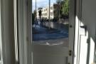 The door, seen here from the inside, is at 45° to both Putney Bridge & Brandlehow Roads.
