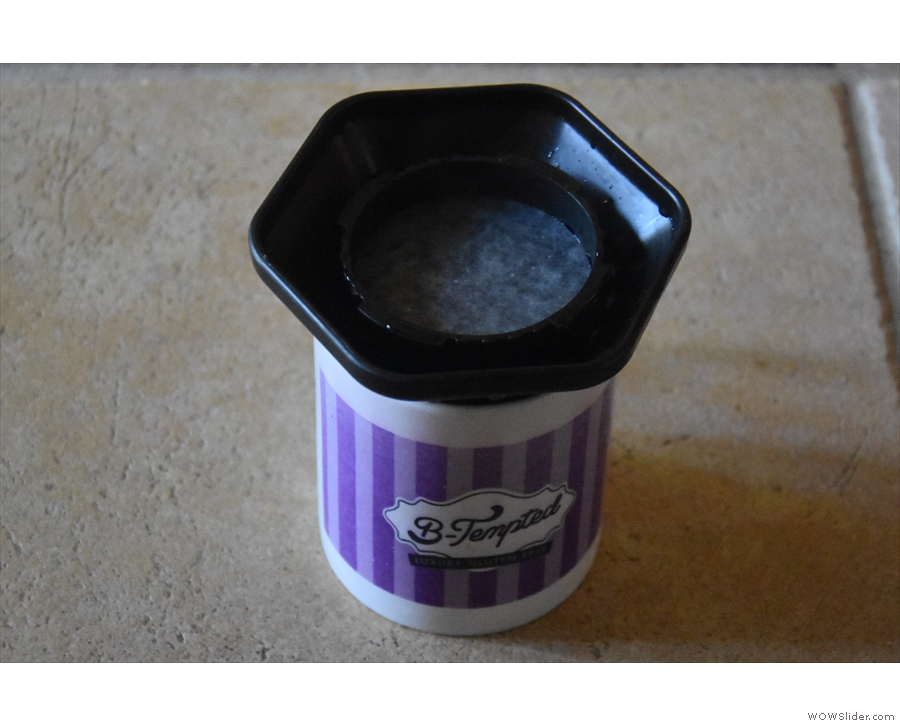 Next, rinse the filter paper using some hot water.