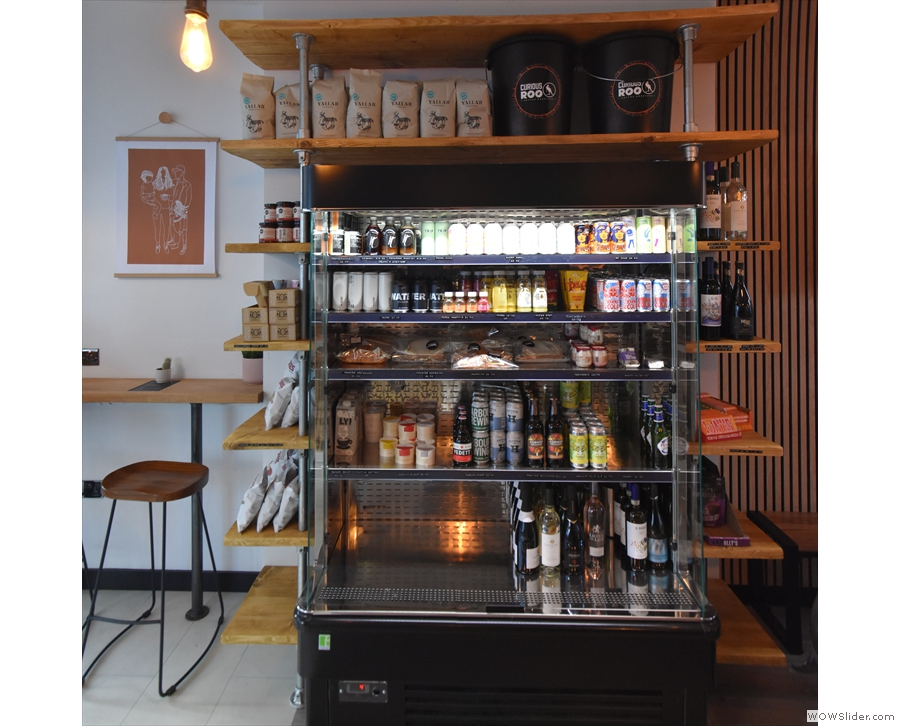 This large chiller cabinet stands opposite the counter. As well as various soft drinks...