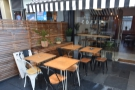 The large, outdoor seating terrace has tables on the left...