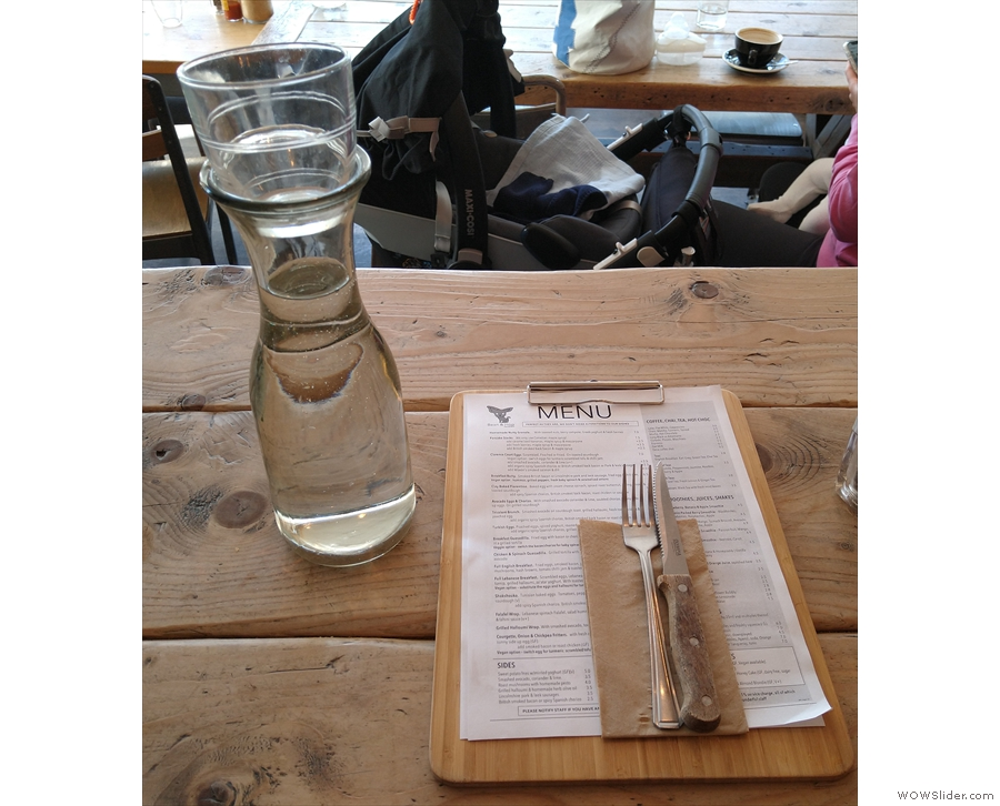 Alternatively, if you're sitting in, you'll be shown to a table with a bottle of water...