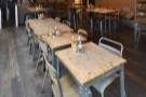 ... and the view the other way. The remaining seating is arranged in rows of tables.