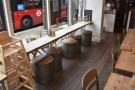 Check out the wooden-topped barrels for seats (and the bus outside at the bus stop).