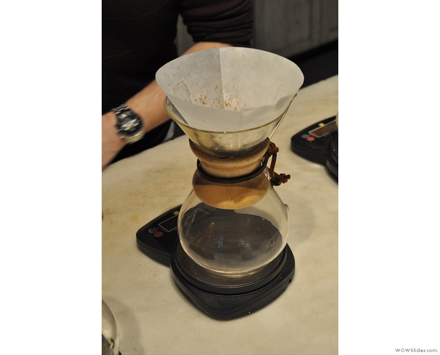 The coffee is placed in the filter, the scales zeroed and the stop-watch reset.