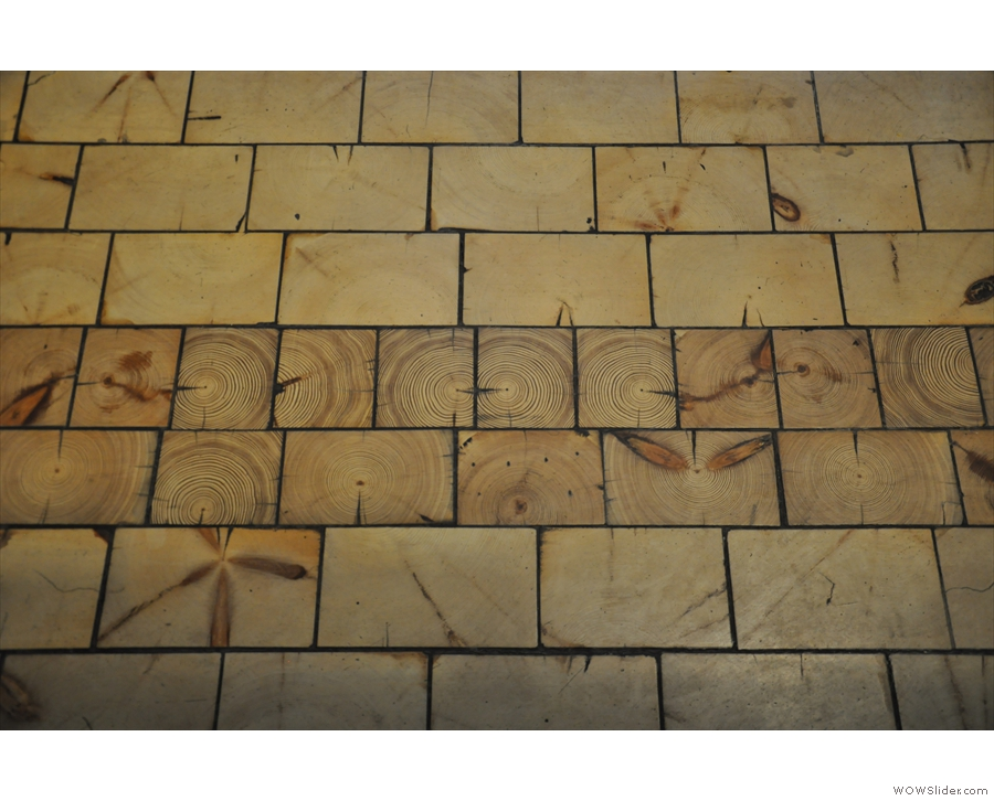 Look at the beautiful wood-tiled floor.