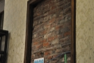 There are some nice features, such as this framed section of bare-brick wall.