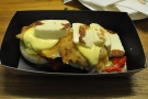 My halloumi, avocado, eggs and peppers on a muffin in Hollandaise sauce.