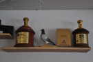 ... and one of two shelves holding all the barista championship trophies 3FE has won!