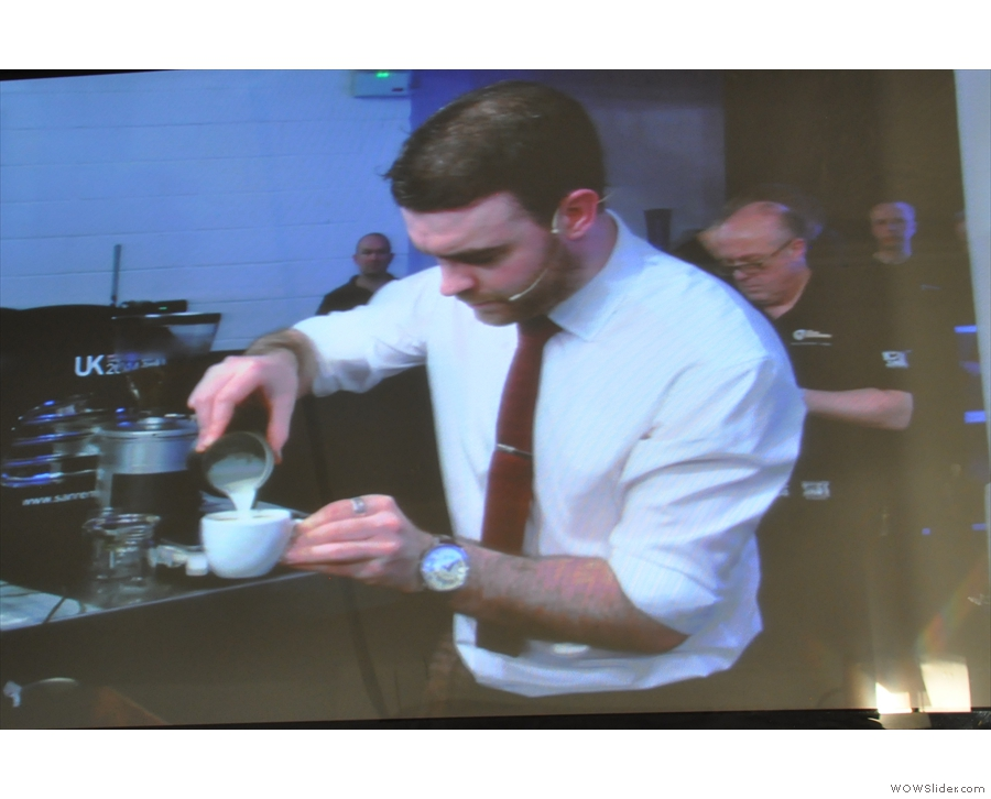 Joe pours the milk for the cappucinos.