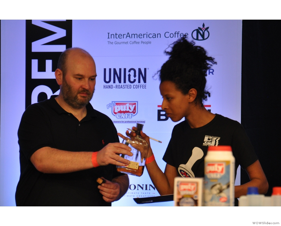While the coffee brews, the judges sniff the vital ingredient: bourbon!
