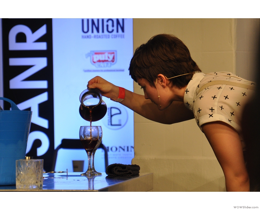 The V60 has finished brewing, so Kate pours it out into the glasses.