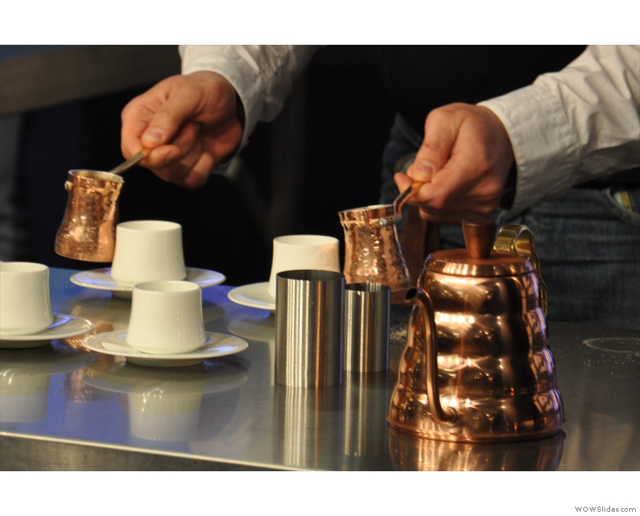 While that's filtering, Valdym pours out coffee for the judges.