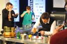 While the judges sample the coffee. Vadym pours the filtered coffee through a tea-strainer.