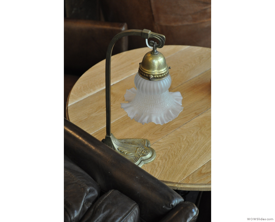 ... as do the numerous lamps, such as this one on the table.