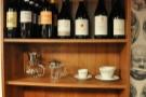 That shelf looks interesting... Coffee and wine, it seems.