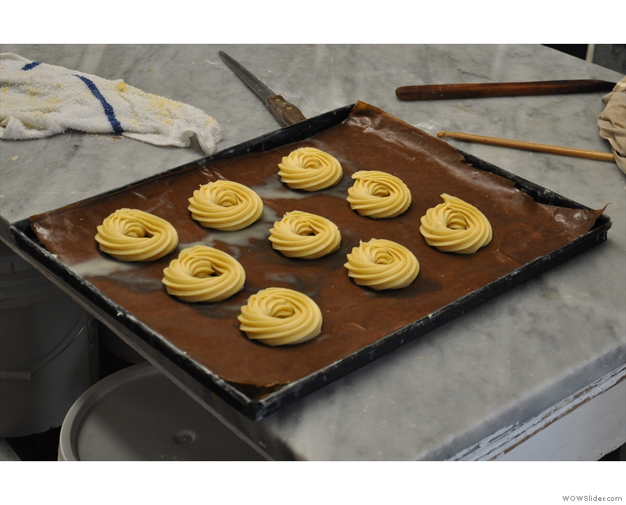 A tray of piped St Joseph's Cakes, waiting to be cooked.