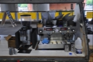 The business end of the espresso machine. Is it me, or is that mounted on a slope?