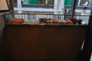 The somewhat depleted cake/sandwich display in the window.