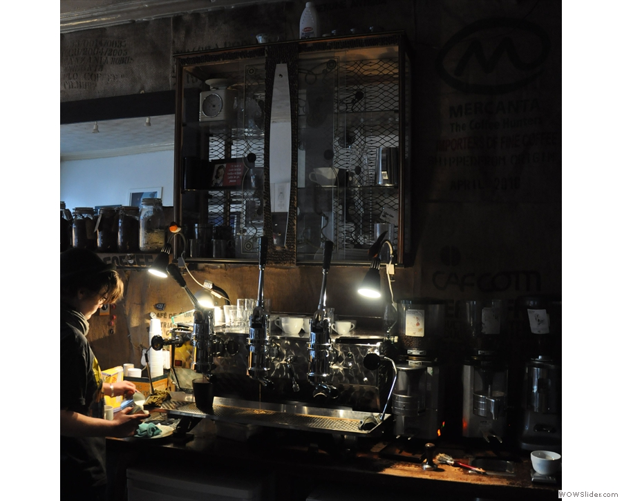 The espresso machine, tucked away in a dark corner...