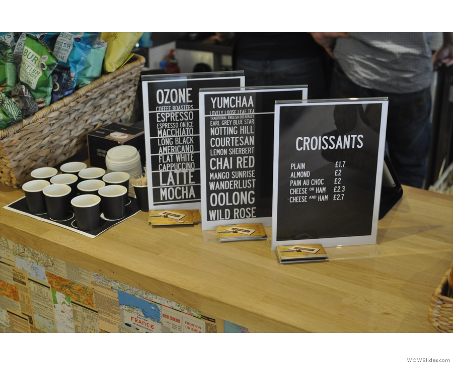 The coffee, tea and croissant menus. The little cups hold samples of each of the loose-leaf teas.