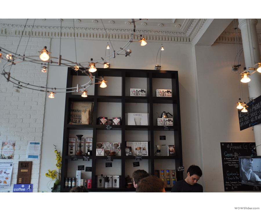 Neat shelves of coffee-making kit sit above the bar.