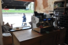 The counter is in two parts. This one faces the window and holds the espresso machine...