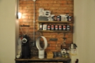 At the far end is this shelf of coffee/kit for sale, plus the EK-43 grinder for filter coffee.