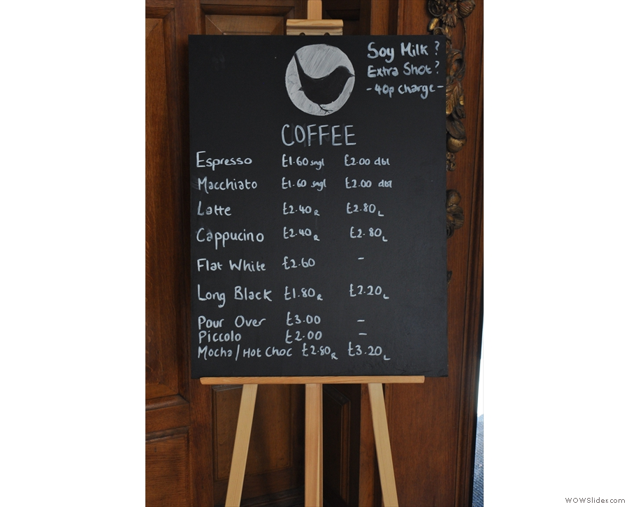 The coffee menu, chalked up by the door.