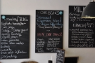 Various other blackboards proclaim the tea, coffee and sandwich options.