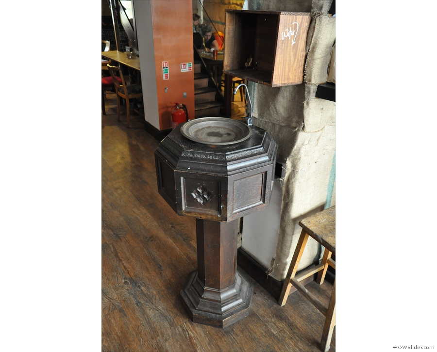 There are lots of neat features, such as this old font pressed into use as a water fountain.