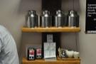 A shelf of coffee and coffee-making kit. And tea.