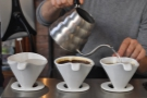 Giovanni prepares a pour-over for another customer.