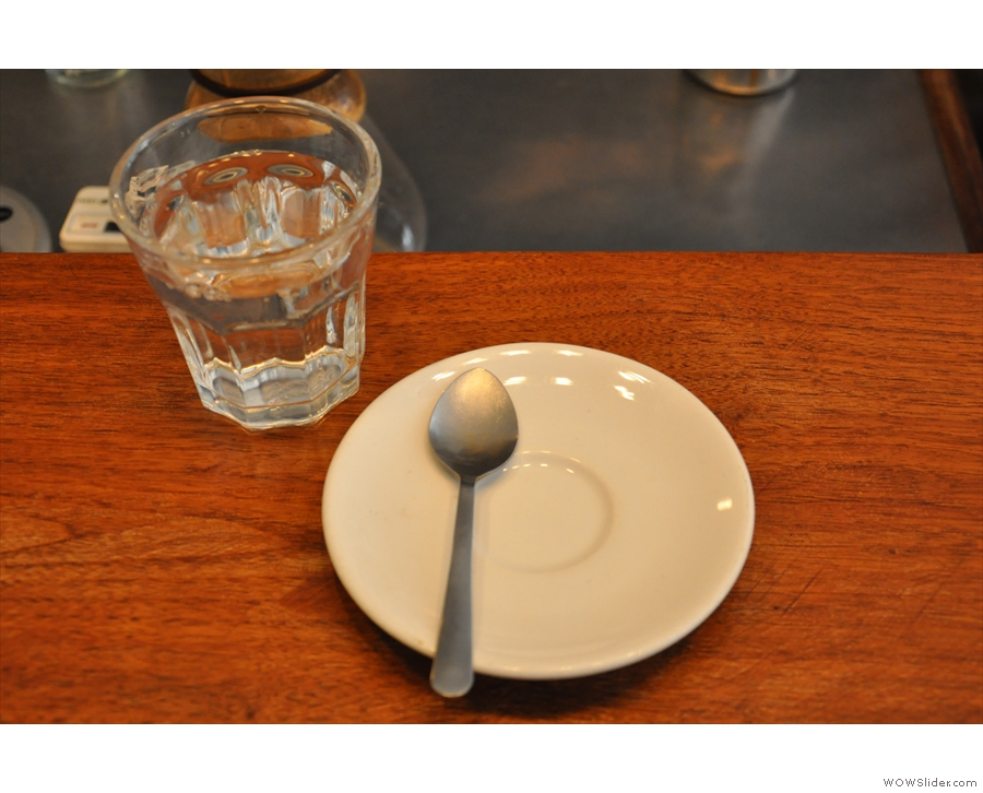 I ordered espresso. My saucer arrived first, complete with glass of water.