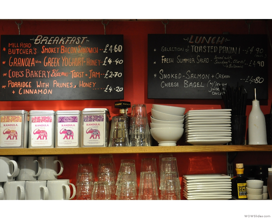 The breakfast and lunch menus are above and behind the counter...