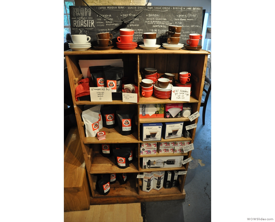 A shelf of coffee and coffee-making kit.