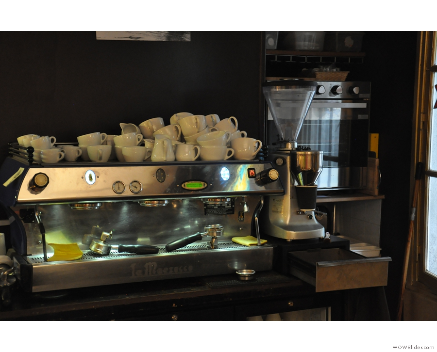 ... complete with a 3-group La Marzocco.