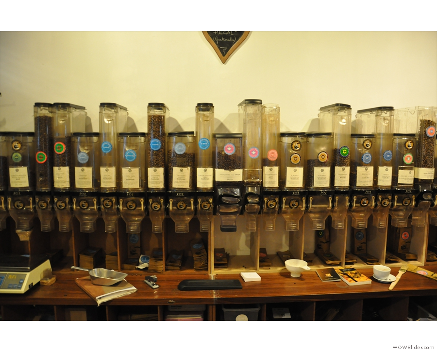 The massed ranks of coffee bins behind the counter.