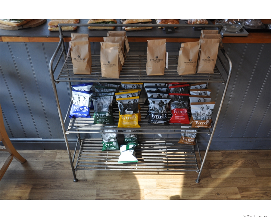 A rack holding that most natural of combinations, crisps and coffee beans.