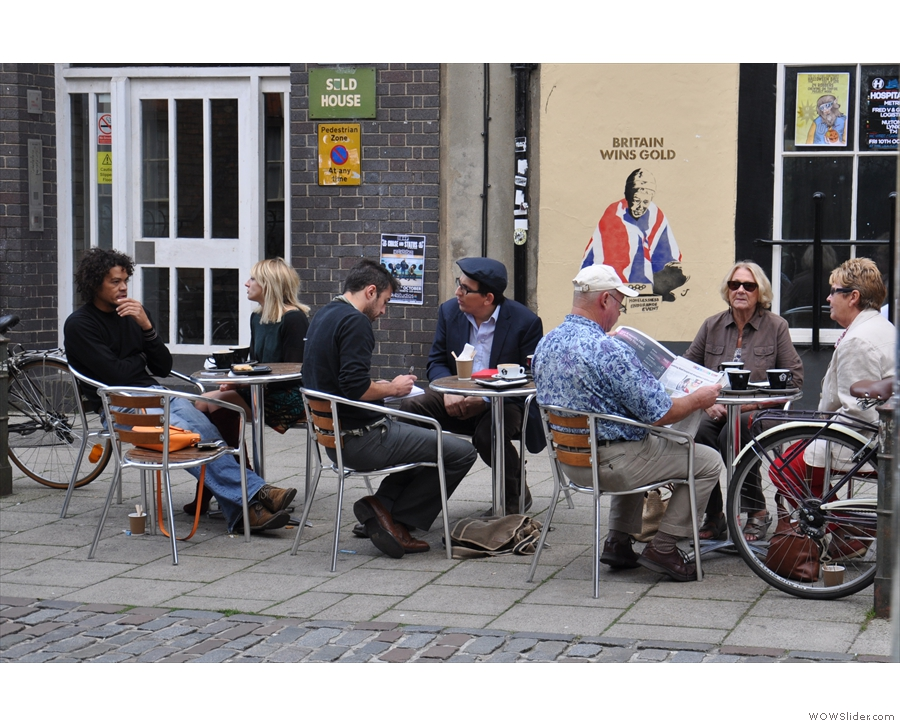 It took me a while to realise that the seats on the other side of the street were Strangers'!
