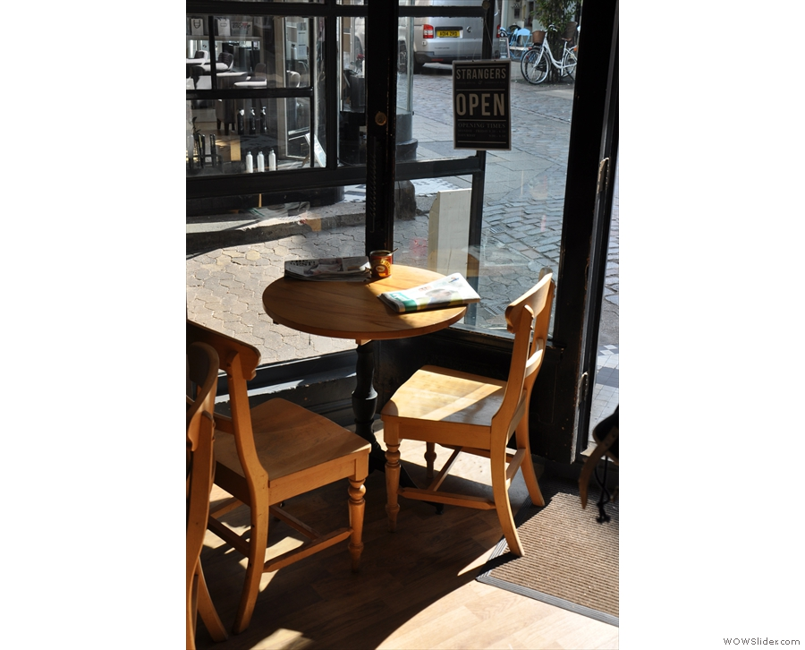 The table by the door is in a sunny spot...