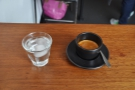 My espresso, which came with its own glass of water.