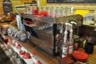The espresso machine was very shiny.
