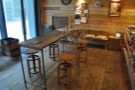 The communal table in the centre of the room.